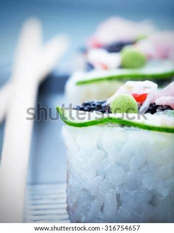 Sushi, soft focus, shallow dof, traditional asian food, luxury nutrition, served with wooden chopsticks, healthy lifestyle concept - stock photo