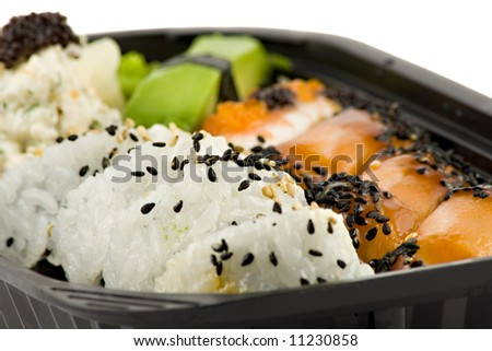 Sushi take-away meal isolated on white background - stock photo