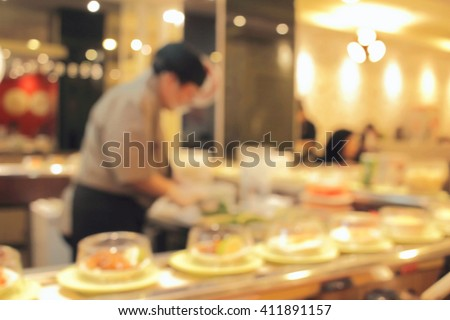sushi train de focused abstract background - stock photo
