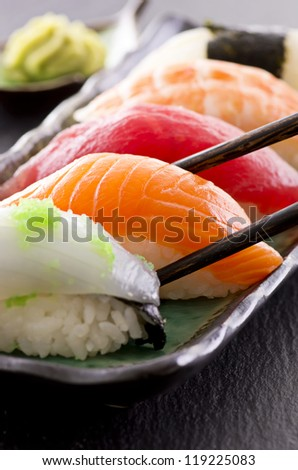 sushi with chop sticks - stock photo