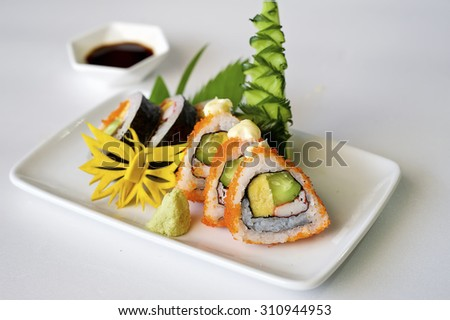 Sushi with wasabi on a plate on white table. - stock photo