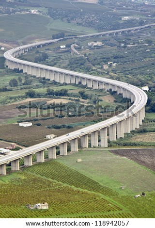 Suspended motorway in the sicilian country - stock photo