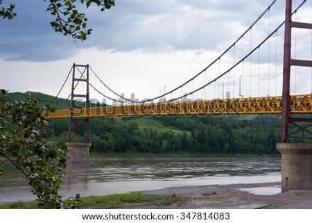 Suspension bridge at Dunvegan spans mighty Peace River, Alberta, Canada - stock photo