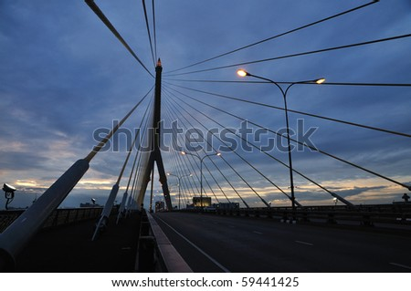 Suspension Bridge at Dusk - stock photo