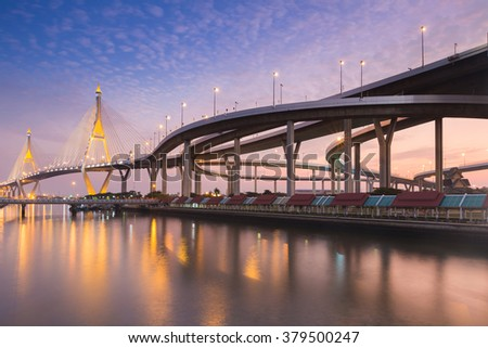 Suspension Bridge connect to highway intersection waterfront with beautiful sky - stock photo