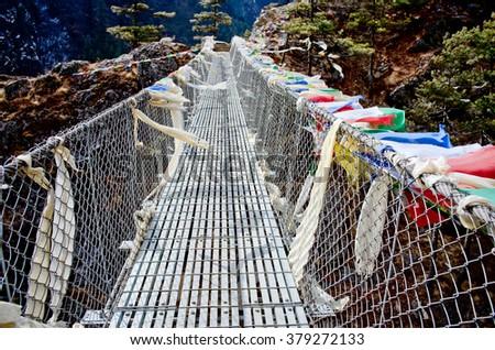 Suspension bridge in Nepal - stock photo