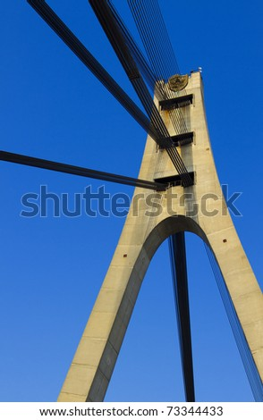 Suspension bridge with cables reaching to the deck of the bridge from the columns - stock photo