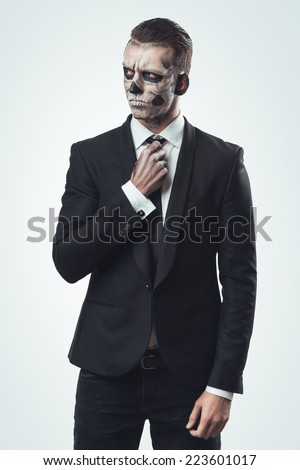 suspicious businesswoman with make-up skeleton - stock photo
