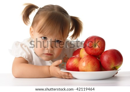 Suspicious greedy child with red apples, isolated over white - stock photo
