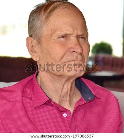 Suspicious senior man portrait - stock photo