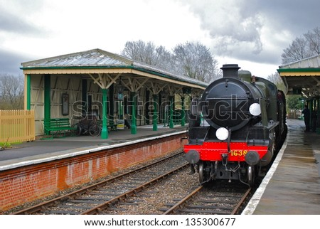 SUSSEX - MARCH 28: Classic steam locomotive at Horstead Keynes during the Bluebell Railway extension celebrations March, 28 2013 in Sussex, England. - stock photo