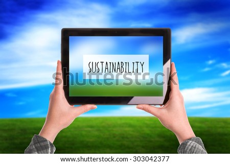 Sustainability Concept, Woman with Digital Tablet Computer Taking Picture of Natural Grassland Landscape - stock photo
