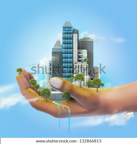 Sustainable city in the palm of the hand - stock photo