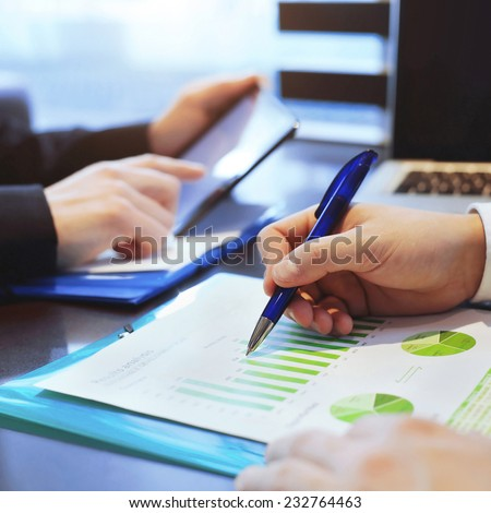 sustainable development, business man analyzes infographic - stock photo