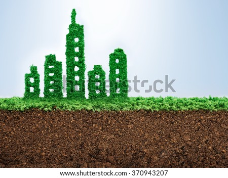 Sustainable urban development concept with grass growing in shape of a city  - stock photo