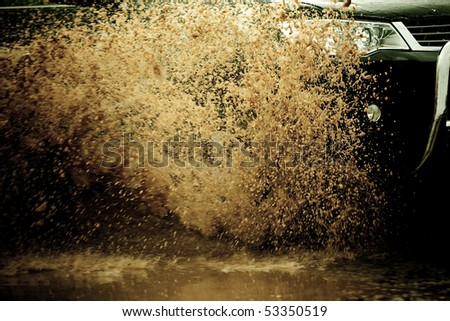 suv splash on the river outdoor ,traveling on the road. - stock photo