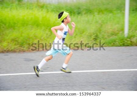 SUVARNABHUMI AIRPORT SAMUT PRAKAN, THAILAND - SEPTEMBER 8: Unidentified marathon runner at Adidas King of the Road 2013 on September 8, 2013 in Suvarnabhumi Airport Samut Prakan, Thailand. - stock photo