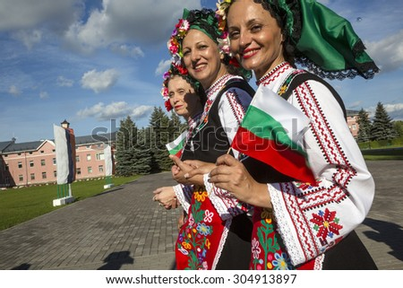 SUZDAL, RUSSIA - AUGUST 08, 2015: Bulgarian women in national costumes take part in the parade during clebration of the City day in Suzdal on 8 of August 2015, Russia - stock photo