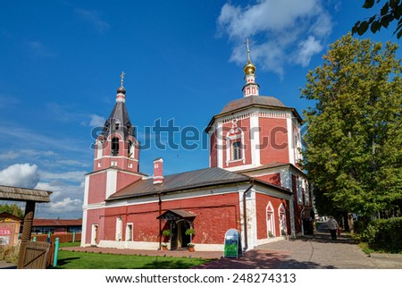SUZDAL, RUSSIA - SEPTEMBER 08, 2014: Temple of the Assumption of the Blessed Virgin Mary in Suzdal. Church of the Assumption refers to a rare in Suzdal Naryshkin baroque style. - stock photo