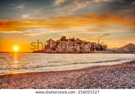 Sveti Stefan Island in Budva, Montenegro with a beautiful sunset in HDR - stock photo