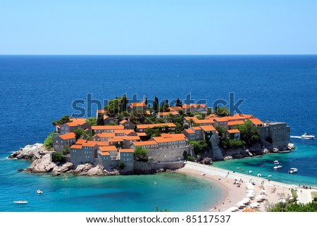 Sveti Stefan peninsula against the blue sky and sea in summer view from above - stock photo
