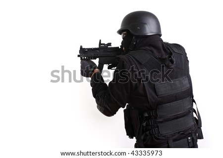 SWAT police officer aiming assault gun. - stock photo