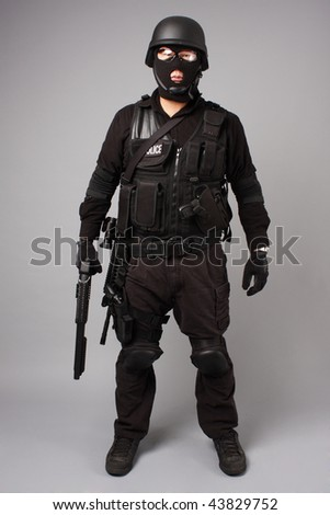 SWAT police officer with shotgun. - stock photo