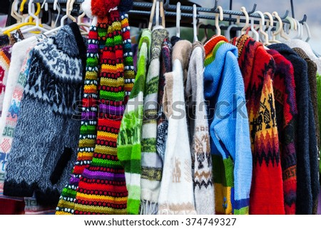 sweaters from alpaca wool on the market in Peru - stock photo