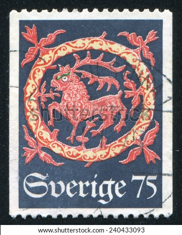 SWEDEN - CIRCA 1974: stamp printed by Sweden, shows Deer, Quilt from Hog Church, circa 1974 - stock photo