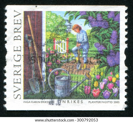 SWEDEN - CIRCA 2005: stamp printed by Sweden, shows Man tending vegetable garden, circa 2005 - stock photo