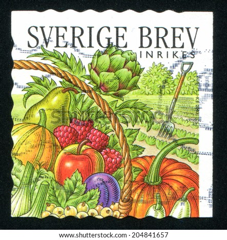 SWEDEN - CIRCA 2003: stamp printed by Sweden, shows Pitchfork, artichoke, pear, gourd, raspberries, apple, plum, pumpkin, eggplant, circa 2003 - stock photo