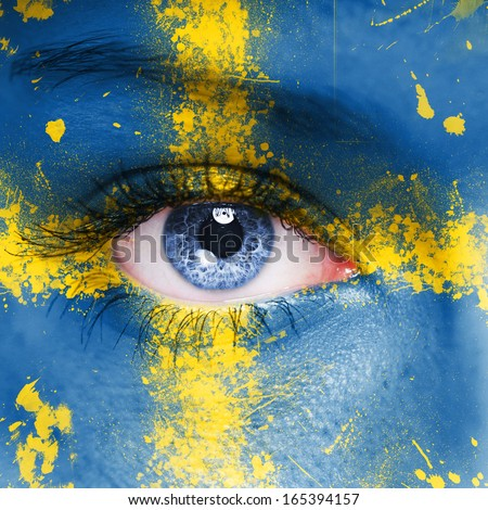 Sweden flag painted on woman face - stock photo
