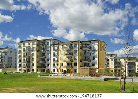 Swedish apartment Block in summer. - stock photo