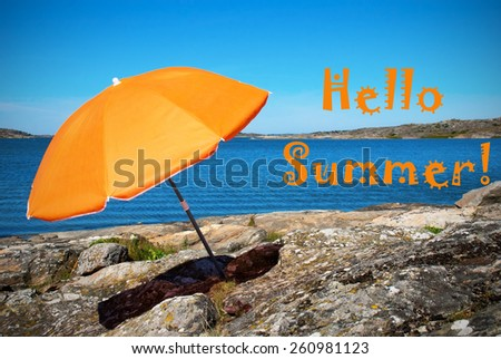 Swedish Coastline Bohuslan Archipelago Close To Gothenburg With Rocks And Cliffs And Beach With Orange Parasol And English Text Hello Summer With Ocean And Open Sea Sunny Weather With Blue Sky - stock photo