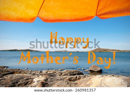 Swedish Coastline Bohuslan Archipelago Swedish West Coast With Rocks And Cliffs And Beach With Orange Parasol And English Happy Mothers Day With Ocean And Sea Sunny Weather With Blue Sky - stock photo
