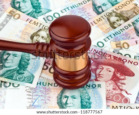 swedish krona, the currency of sweden. cost of the rule of law and justice - stock photo