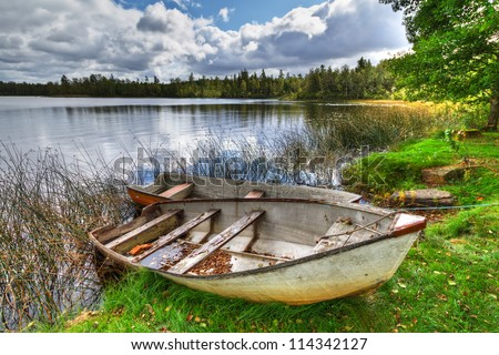 Swedish lake with boat in summer time - stock photo