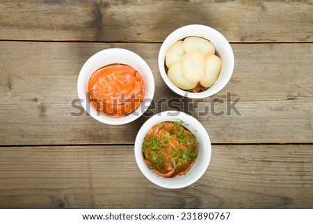 Swedish marinated salmon - gravlux with potatoes and dill in the cups. Top view - stock photo