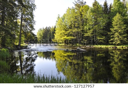 Swedish river and natural salmon area in spring. Farnebofjarden national park - stock photo