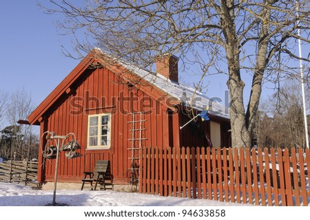 Swedish rural house in a winters surrounding - stock photo
