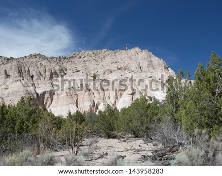 Sweeping wide angle view of Tent Rocks National Monument at Cochiti Pueblo in Sandoval County, New Mexico, USA - stock photo