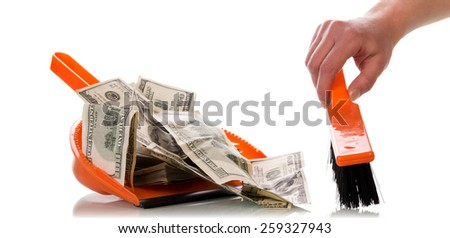 Sweeps dollar bills money in the scoop, isolated on white background - stock photo