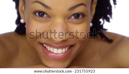 Sweet African woman showing off her pearly whites - stock photo