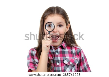 sweet and beautiful little girl in the blouse looks amazing with a loupe on white isolated background - stock photo