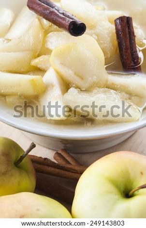 Sweet and fresh apple compote with cinnamon. - stock photo