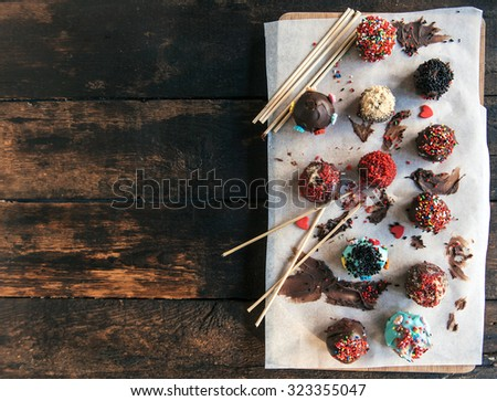 Sweet and homemade chocolate cake pops on wooden background,blank space  - stock photo
