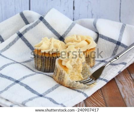 Sweet and homemade vanilla cupcakes - stock photo