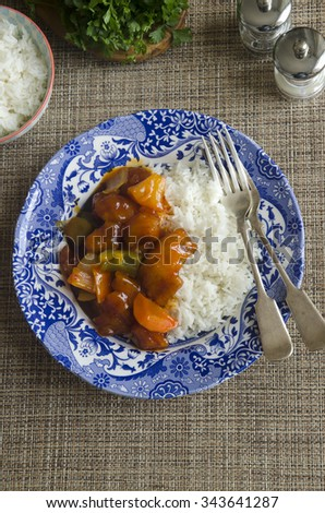 Sweet and sour chicken with basmati rice - stock photo