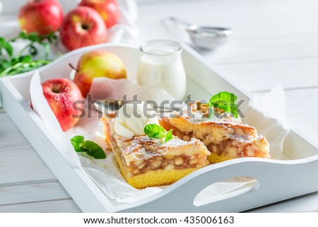 Sweet apple pie and ice cream with mint leaves - stock photo