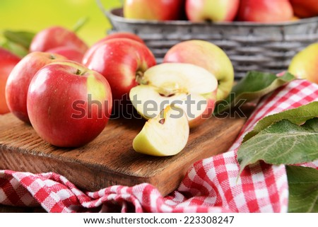 Sweet apples  on table on bright background - stock photo